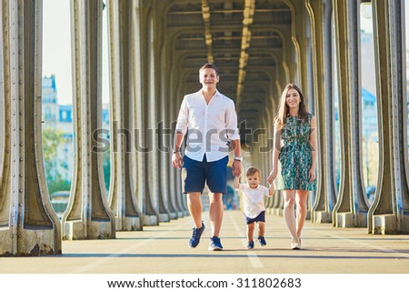 Happy family of three enjoying their vacation in Paris, France - stock photo