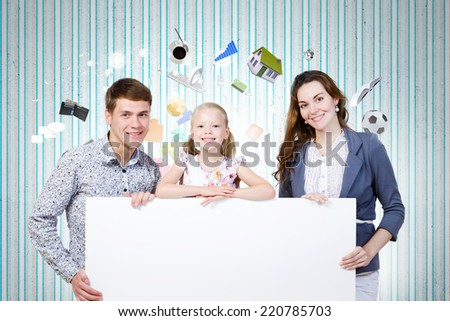 Happy family of three holding white blank banner. Place for text - stock photo