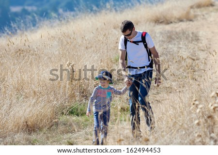 happy family of two enjoying nature hike together - stock photo