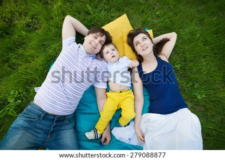 happy family on a blanket in the garden - stock photo
