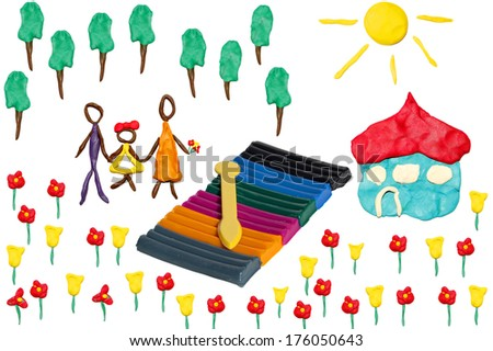 Happy family on a blossoming meadow near the own house (objects are executed from color plasticine). - stock photo
