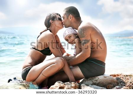 Happy family on a vacation day - stock photo