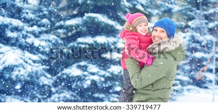 Happy family on a winter walk in nature. Dad and child baby girl - stock photo