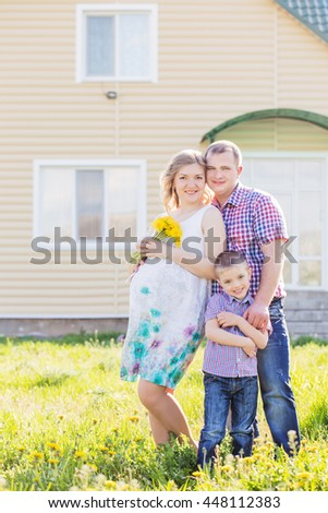 happy family on background house - stock photo