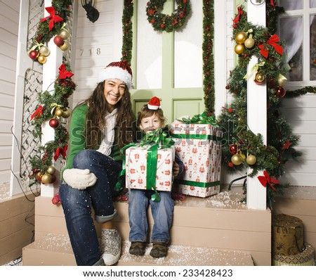 happy family on Christmas in red hats waiting gests and smiling - stock photo
