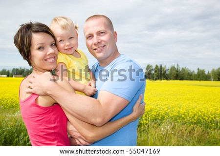 Happy family on countryside - stock photo