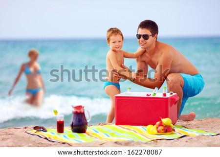 happy family on summer beach picnic - stock photo