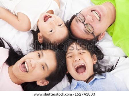Happy   family on the floor  - stock photo