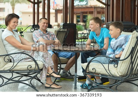 Happy family on the table - stock photo