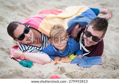 happy family on vacation on the beach - stock photo