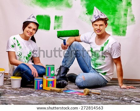 Happy family paint wall at home. Green paint. - stock photo