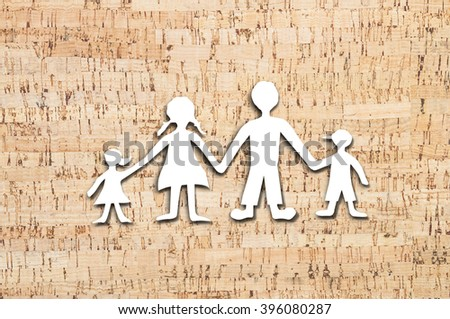 Happy family paper cut on cork board texture. - stock photo