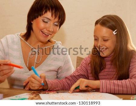 Happy family. play noughts crosses. - stock photo