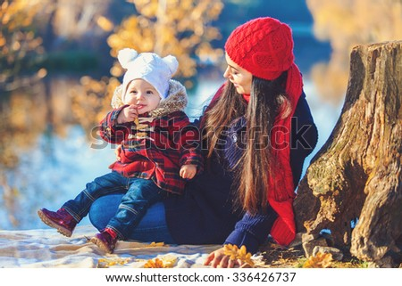 Happy family playing outdoors in park, Winter, autumn life - stock photo