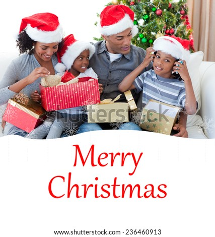 Happy family playing with Christmas presents against merry christmas - stock photo