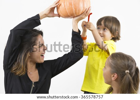 Happy Family Playing with Pumpkin, Eating Healthy Food - stock photo