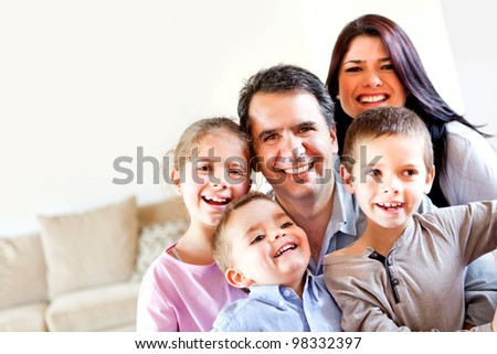 Happy family portrait having fun at home and smiling - stock photo