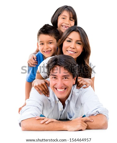 Happy family portrait lying on the floor - isolated over a white background  - stock photo