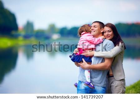 happy family portrait, outdoors - stock photo