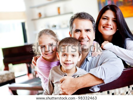 Happy family portrait smiling together at home - stock photo