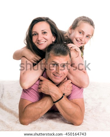 Happy family posing on a white background - stock photo