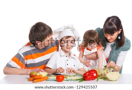 Happy Family Preparing a salad Together. Isolated white background - stock photo
