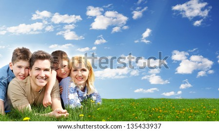 Happy family relaxing at the park. Summer vacation. - stock photo