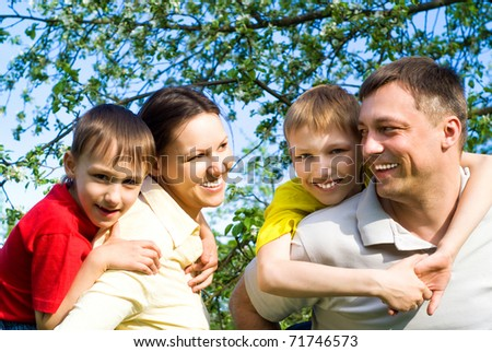 happy family resting on the nature - stock photo