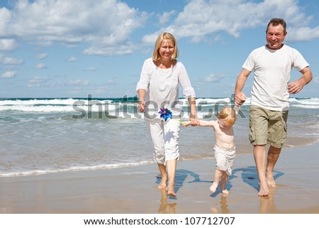 Happy family resting on the sea - stock photo