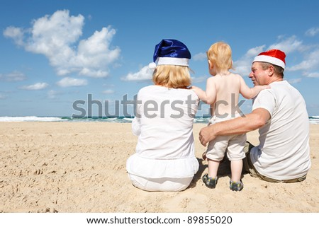 Happy family resting on the sea on the eve of new year - stock photo