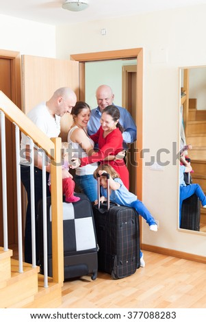 Happy family seeing off the relatives to vacations - stock photo