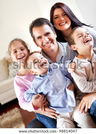 Happy family smiling and having fun together at home - stock photo