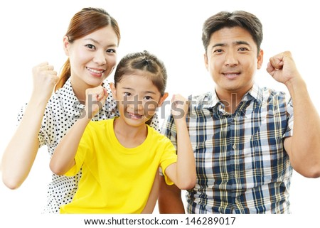 Happy family smiling together - stock photo