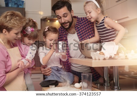 Happy family spending time in the kitchen  - stock photo