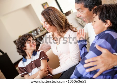 Happy family spending time together at home - stock photo