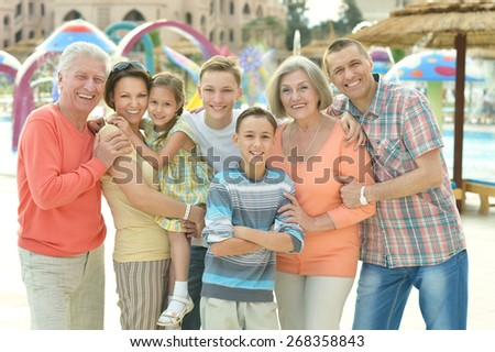 Happy family spending time together in water park - stock photo