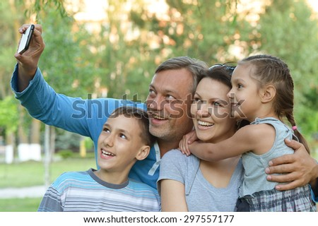 Happy family taking selfie on the sea beach - stock photo