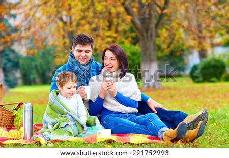 happy family together on autumn picnic - stock photo