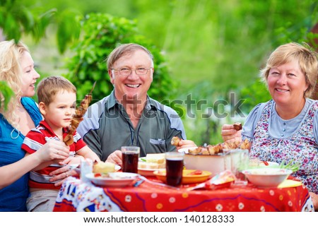 happy family together on picnic, summer outdoors - stock photo