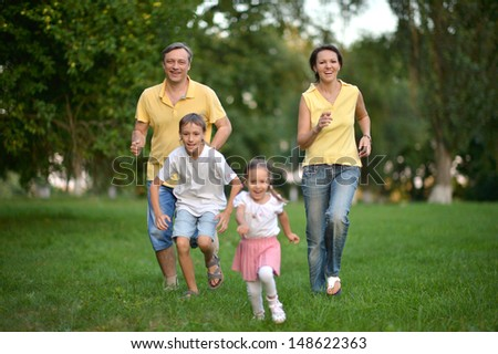 happy family walking in the park - stock photo