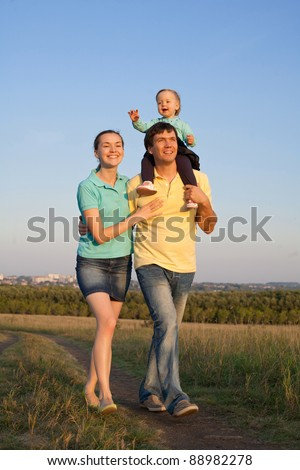 Happy Family walking outdoors - stock photo