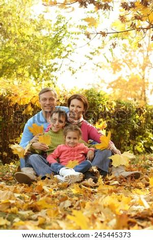 Happy family walks in the autumn park - stock photo