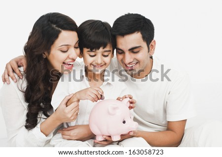 Happy family with a piggy bank - stock photo