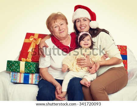 happy family with box gift, woman with child and elderly - holiday concept - stock photo