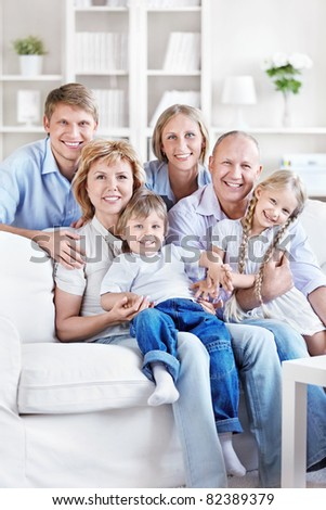 Happy family with children and grandchildren at home - stock photo