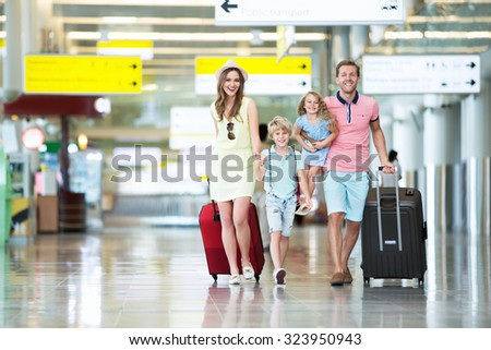 Happy family with children at the airport - stock photo