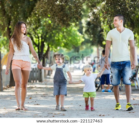 Happy family with children holding vacation day outdoor - stock photo