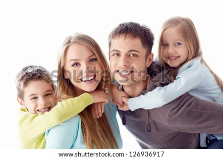 Happy family with children on white background - stock photo