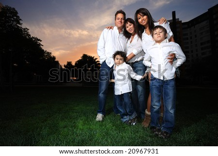 Happy family with children outdoors - stock photo