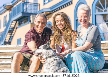 Happy family with dog spending time together. Concept about family and animals - stock photo